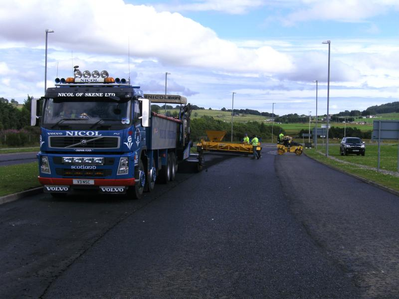Team laying surfacing on the A944